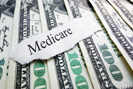Medicare and 100 dollar bills